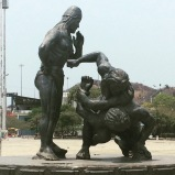 Native Statues Wrestle
